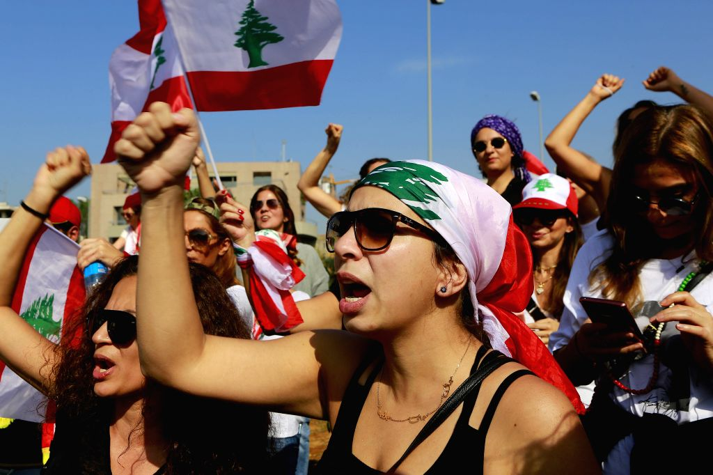 BEIRUT, Nov. 13, 2019 - People take part in a protest in Baabda, southeast of Beirut, Lebanon, on Nov. 13, 2019. Thousands of Lebanese demonstrators blocked streets all over Lebanon on Wednesday to ...