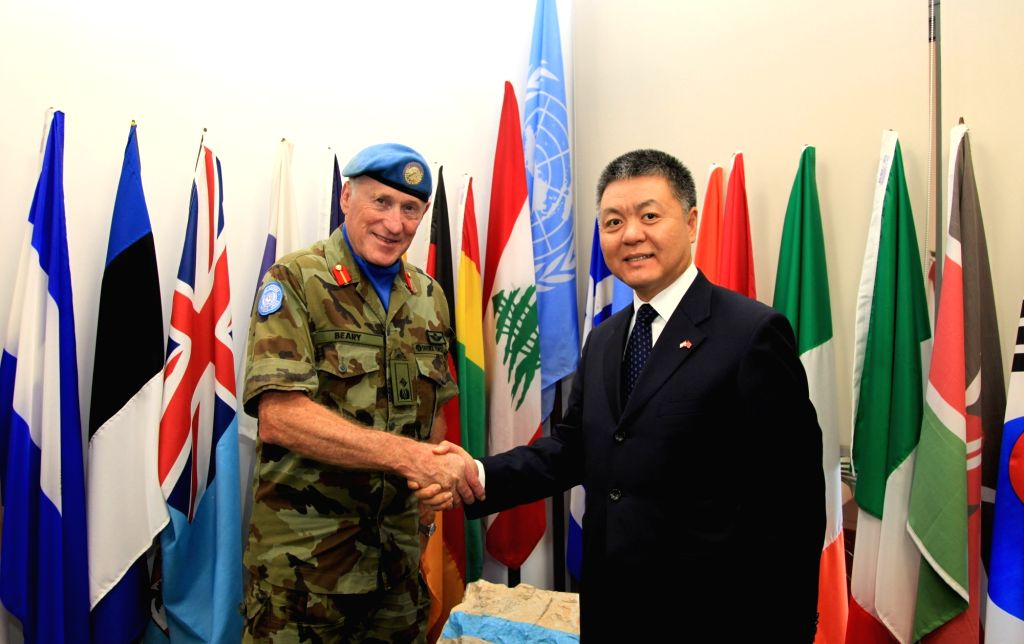 BEIRUT, Oct. 10, 2017 - Chinese Ambassador to Lebanon Wang Kejian (R) shakes hands with Michael Beary, head of Mission and Force Commander of United Nations Interim Force in Lebanon (UNIFIL), at the ...