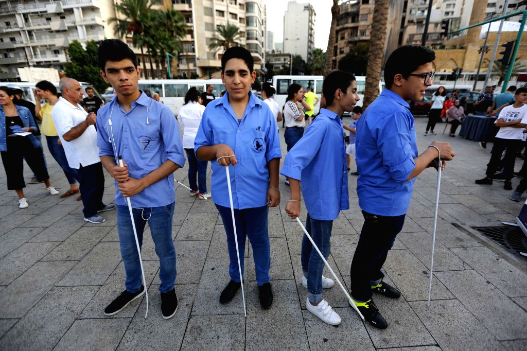 BEIRUT, Oct. 16, 2019 - A group of blind boys take part in the White Cane Safety Day event held in Beirut, Lebanon, on Oct. 16, 2019. Some welfare institutions in Lebanon organized activities for ...