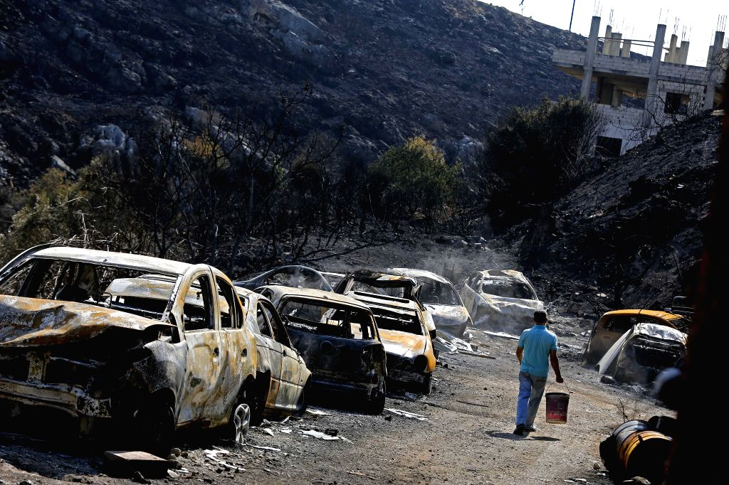 BEIRUT, Oct. 16, 2019 - Destroyed cars are seen after a fire in Damour District, south of Beirut, Lebanon, Oct. 16, 2019. Hectares of the mountains and a number of houses were destroyed by the ...