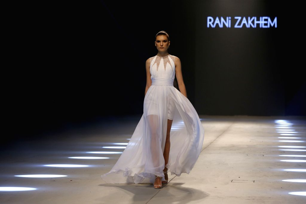 "BEIRUT, Oct. 8, 2019 - A model presents a creation by Lebanese designer Rani Zakhem during the ""Designers & Brands"" fashion show in Beirut, Lebanon, on Oct. 8, 2019."