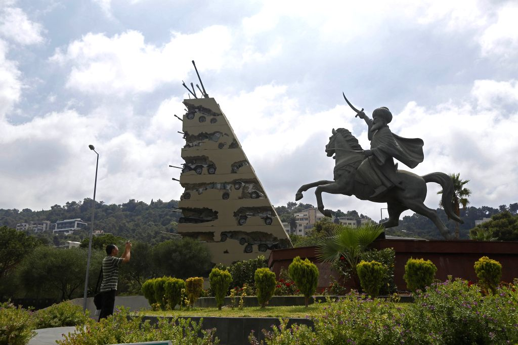 BEIRUT, Sept. 13, 2019 - A tourist takes pictures of the Hope for Peace Monument in Yarzeh, Lebanon, Sept. 13, 2019. The Hope for Peace Monument, designed by French-born American artist Armand ... - Armand Fernandez