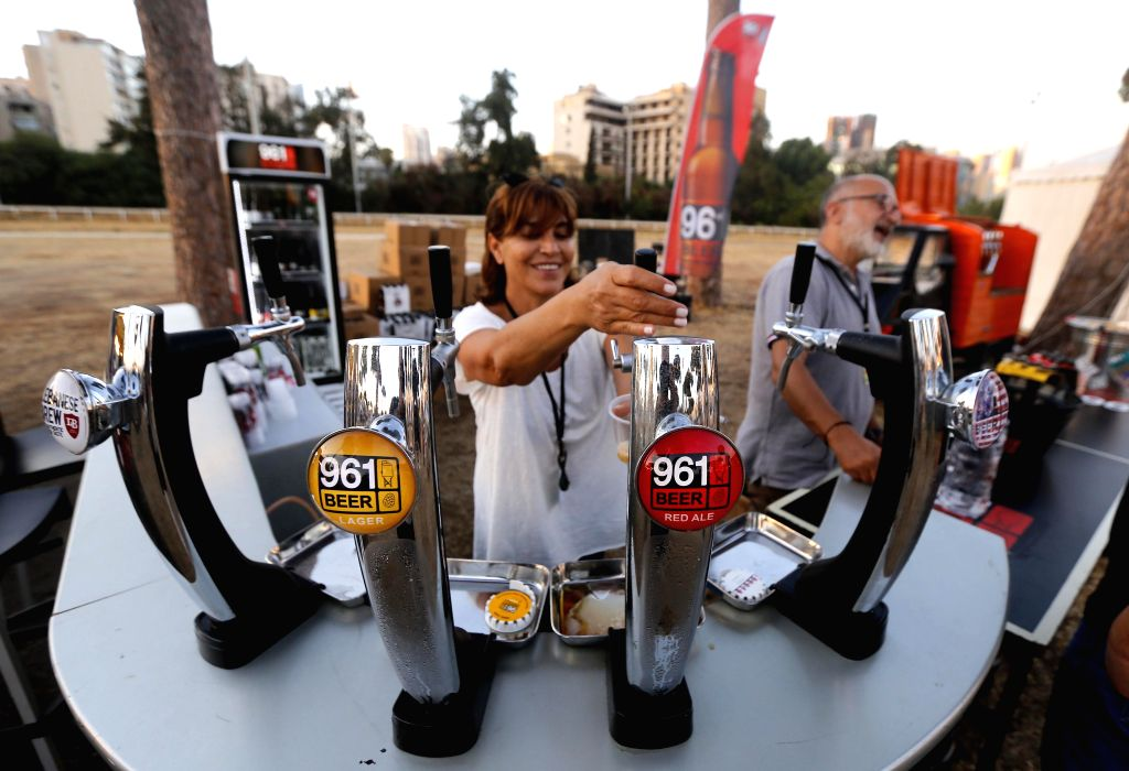 BEIRUT, Sept. 15, 2018 - An exhibitor fills a glass with beer at the second editon of the Beirut International Beer Event(BIBE) held in Beirut, capital of Lebanon, on Sept. 14, 2018.