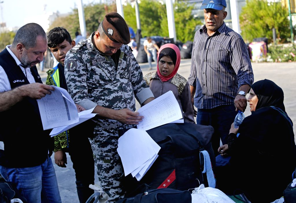 BEIRUT, Sept. 18, 2018 - Lebanese police check the identity of Syrian people before their returning to Syria in Beirut, Lebanon, on Sept. 17, 2018. On Monday, Syrian refugees met in the early morning ...
