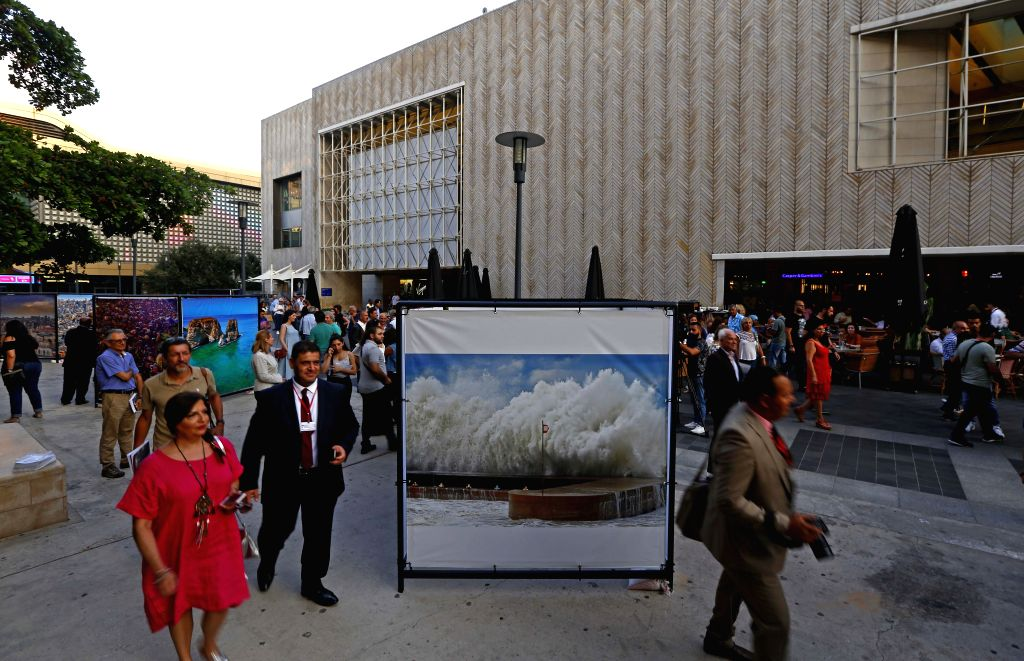 BEIRUT, Sept. 4, 2019 - People attend the opening exhibition of the Beirut Image Festival 2019 in Beirut, Lebanon, on Sept. 4, 2019. The Beirut Image Festival 2019 kicked off on Wednesday in Beirut. ...