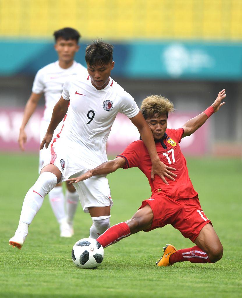 BEKASI, Aug. 10, 2018 - Chung Wai Keung (L) of Hong Kong of China vies with Bounkong Bounpachan of Laos during the Men's Football Group A match at the 18th Asian Games at Patriot Stadium in Bekasi, ...