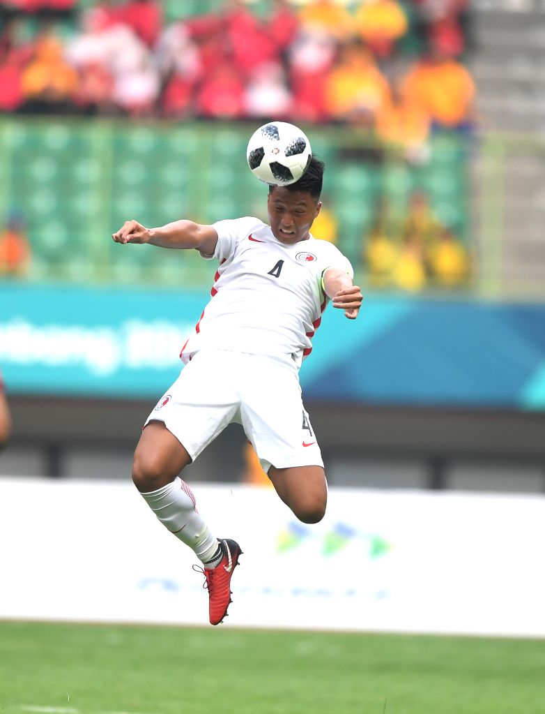 BEKASI, Aug. 10, 2018 - Lau Hok Ming of Hong Kong of China competes during the Men's Football Group A match between Hong Kong of China and Laos at the 18th Asian Games at Patriot Stadium in Bekasi, ...