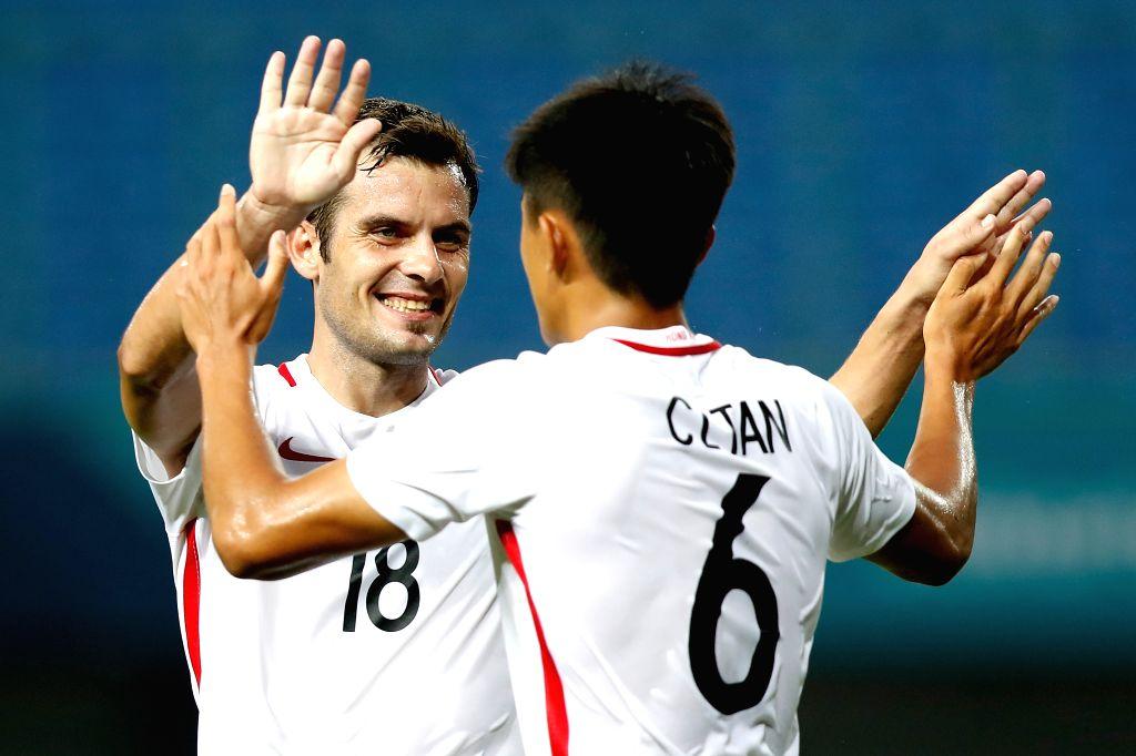 BEKASI, Aug. 10, 2018 - Tan Chun Lok (R) of Hong Kong of China celebrates with his teammate Jorge Tarres Paramo after scoring during the Men's Football Group A match between Hong Kong of China and ...