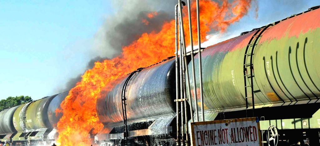 A fire breaks out in an oil wagon rake belonging to Indian Oil while transferring fuel at a depot in Belagavi, Karnataka on Jan 10, 2015.