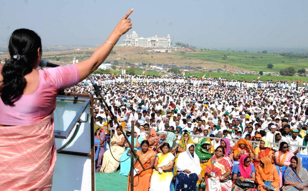 BJP leader Shoba Karandlaje addresses during a demonstration organised in support of the various demands of sugarcane farmers in front of Suvarna Soudha, in Belagavi, Karnataka on Dec 9, ...