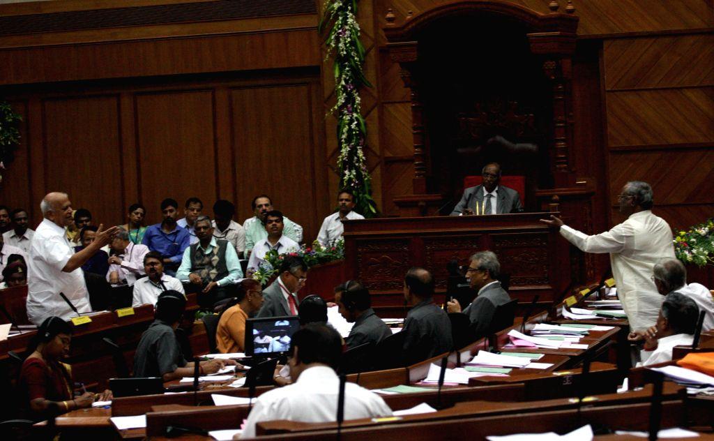 Karnataka BJP legislator K B Shanappa argues with Karnataka Minister S R Patil during the winter session of Karnataka assembly at Suvarna Soudha, in Belagavi on Dec 16, 2014. - S R Patil