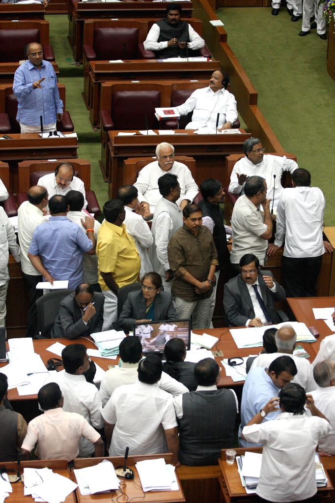 Opposition leaders stage a protest against the sugarcane pricing system during the winter session of Karnataka assembly at Suvarna Soudha, in Belagavi on Dec 15, 2014.