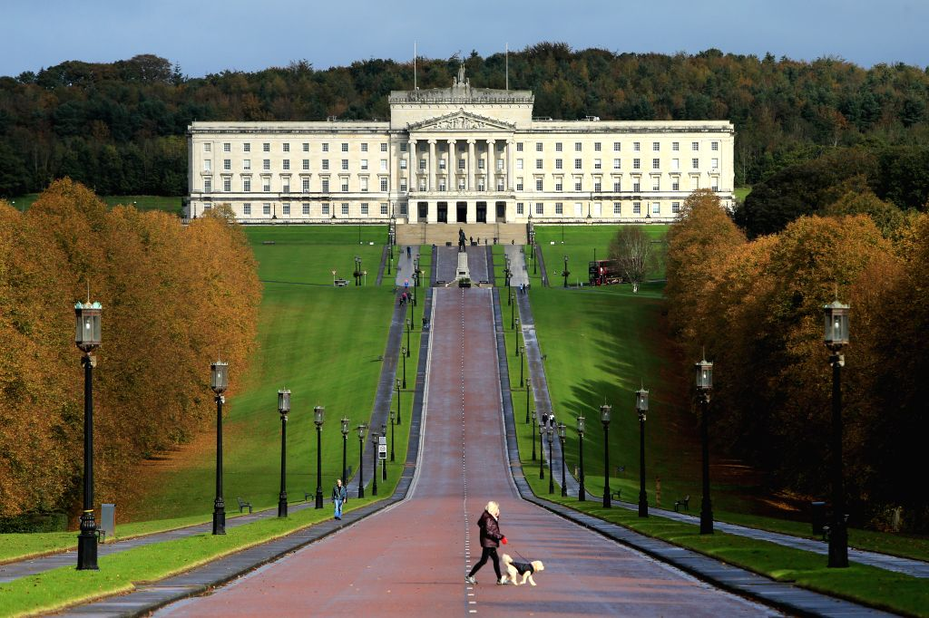 BELFAST, Oct. 19, 2019 (Xinhua) -- A woman walks her dog inside the grounds of Stormont in east Belfast, Northern Ireland, the United Kingdom, on Oct. 19, 2019. British lawmakers on Saturday voted for a key amendment to force British Prime Minister B - Boris Johnson
