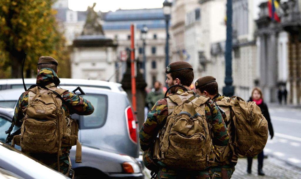 "Belgian soldiers patrol in Brussels, capital of Belgium, on Nov. 21, 2015. The terror threat level in the Brussels region was increased to ""maximum"" on ... - Charles Michel"