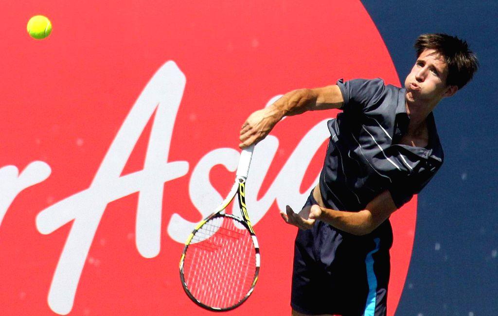 Belgium`s Yannick Mertens in action against Saketh Myneni of India during ATP Challenger Tour at KSLTA, in Bengaluru, on Oct 23, 2015.