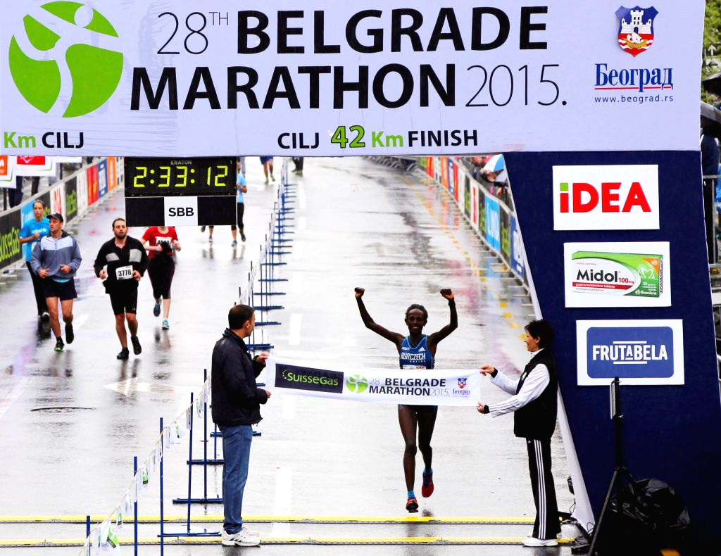 Abebu Gelan Adugna (C) from Ethiopia reaches the finish line after 2 hours 33 minutes and 12 seconds in the female race of 28th Belgrade Marathon in Belgrade, ...