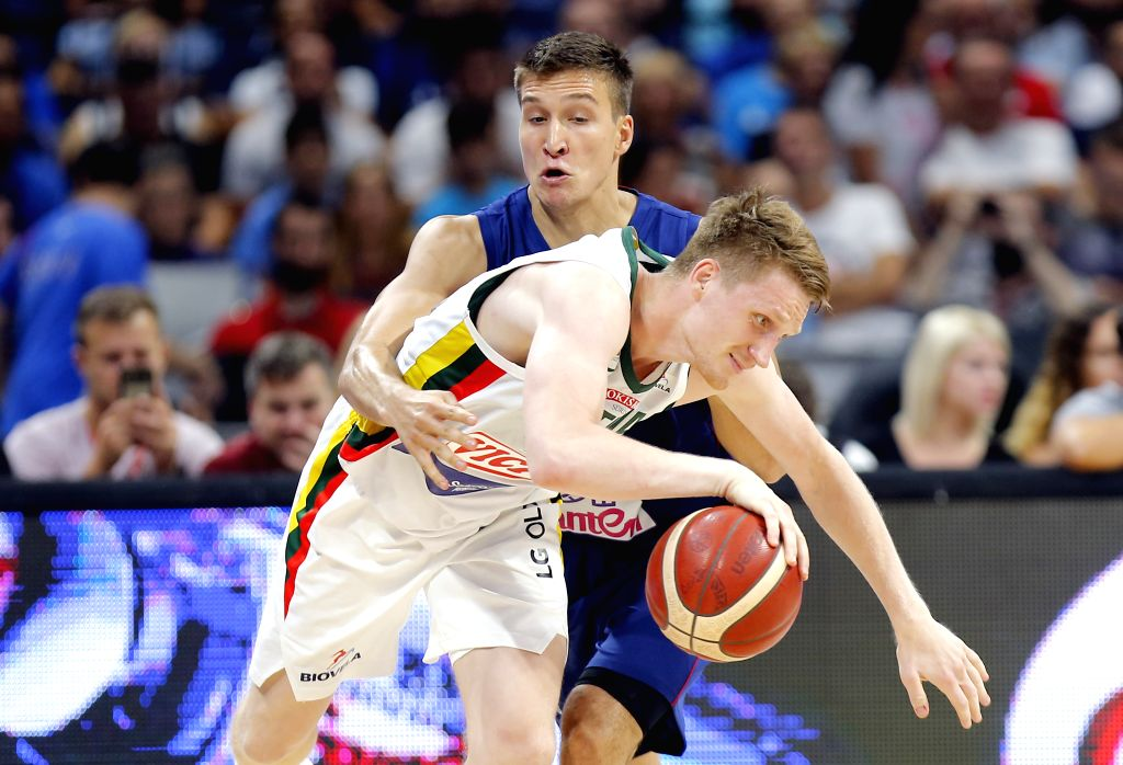 BELGRADE, Aug. 11, 2019 - Lithuania's Marius Grigonis (Front) is fouled by Serbia's Bogdan Bogdanovic during a friendly basketball match between Serbia and Lithuania in Belgrade, Serbia on Aug. 10, ...