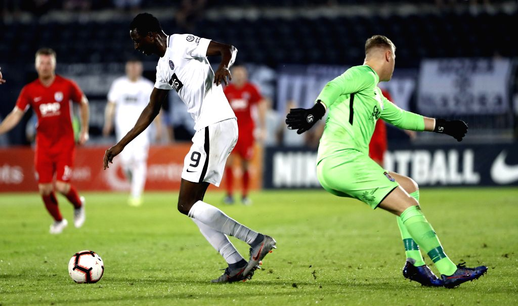 BELGRADE, Aug. 2, 2019 - Partizan's Umar Sadiq (L) vies with Connahs Quay Nomads' goal keeper Lewis Brass during UEFA Europa League second qualifying round match between Partizan of Serbia and ...