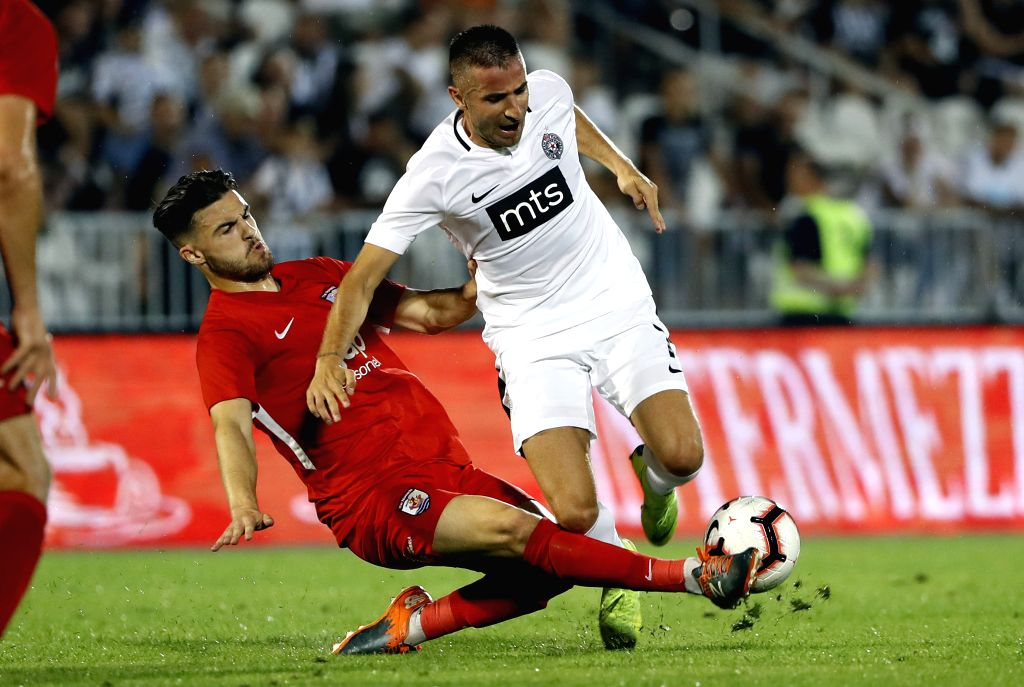 BELGRADE, Aug. 2, 2019 - Partizan's Zoran Tosic (R) vies with Connahs Quay Nomads' Callum Roberts during UEFA Europa League second qualifying round match between Partizan of Serbia and Connahs Quay ...