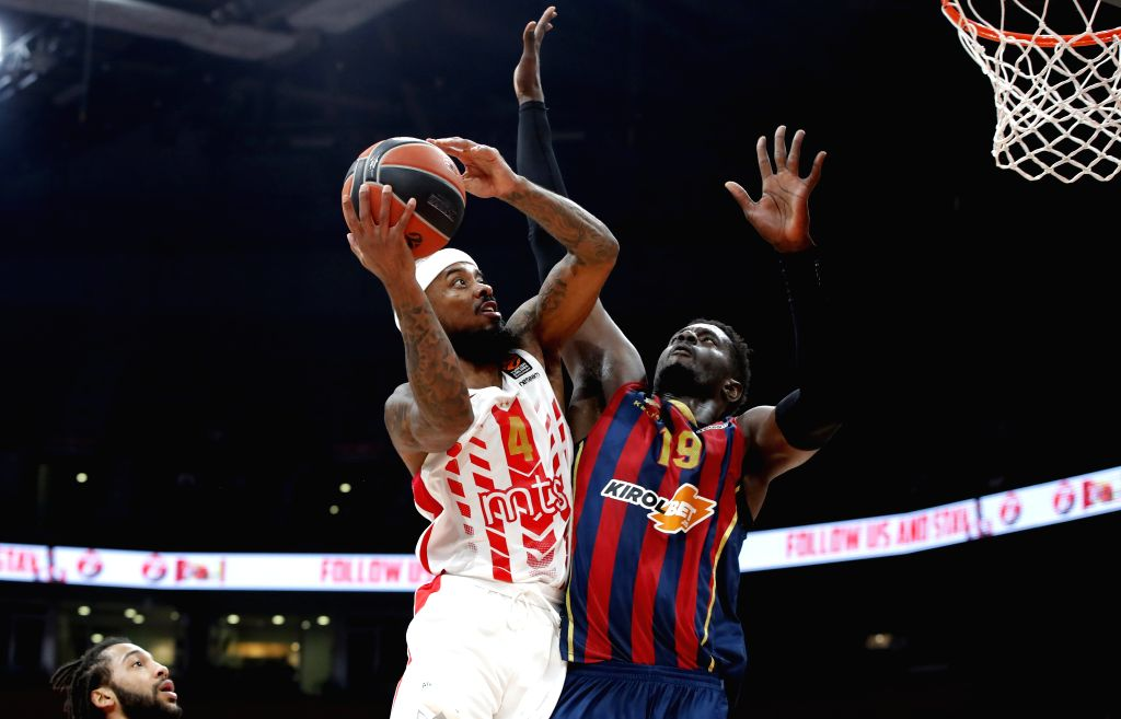 BELGRADE, Dec. 13, 2019 - Crvena Zvezda's Lorenzo Brown (L) goes up for basket against Baskonia's Youssoupha Fall during the regular season round 13 of the Euroleague basketball match between Crvena ...
