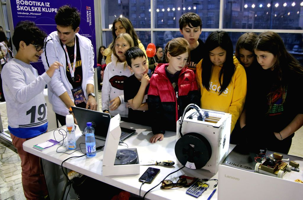 BELGRADE, Dec. 6, 2019 - Kids explore how robots work at the 13th Science Festival in Belgrade, Serbia, Dec. 5, 2019. Hundreds of scientists and science presenters gathered here to transfer their ...