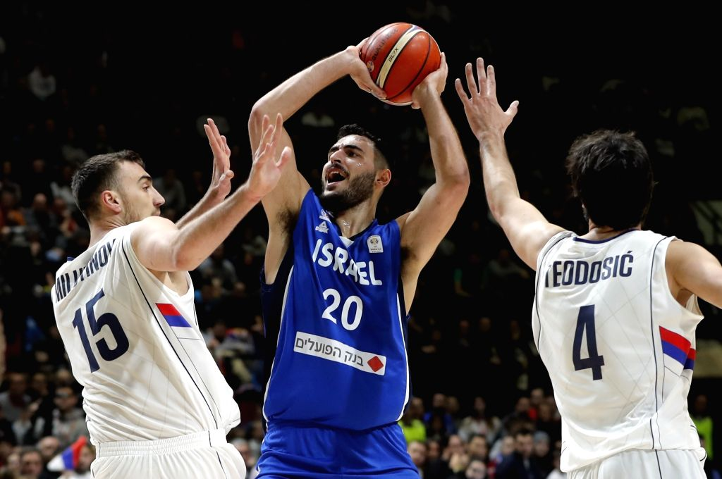 BELGRADE, Feb. 25, 2019 - Israel's Idan Zalmanson (C) vies with Serbia's Nikola Milutinov (L) and Milos Teodosic during FIBA World Cup group L basketball qualifying match between Serbia and Israel in ...