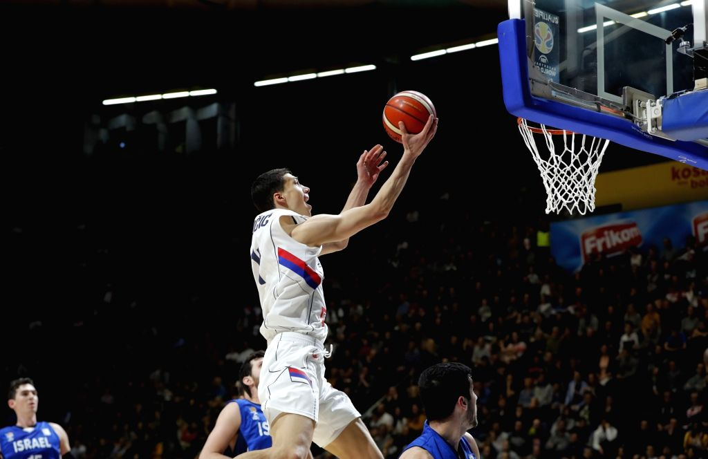 BELGRADE, Feb. 25, 2019 - Serbia's Vladimir Lucic (Top) competes during FIBA World Cup group L basketball qualifying match between Serbia and Israel in Belgrade, Serbia, on Feb. 24, 2019. Serbia won ...