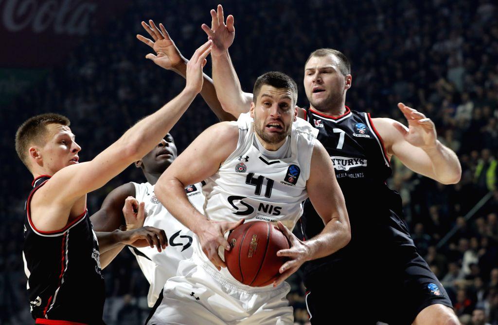 BELGRADE, Jan. 31, 2019 - Partizan's Djordje Gagic (C) vies with Rytas' Arnas Butkevicius (L) and Artsiom Parakhouski during the Top 16 round 5 Eurocup basketball match between Partizan and Rytas in ...
