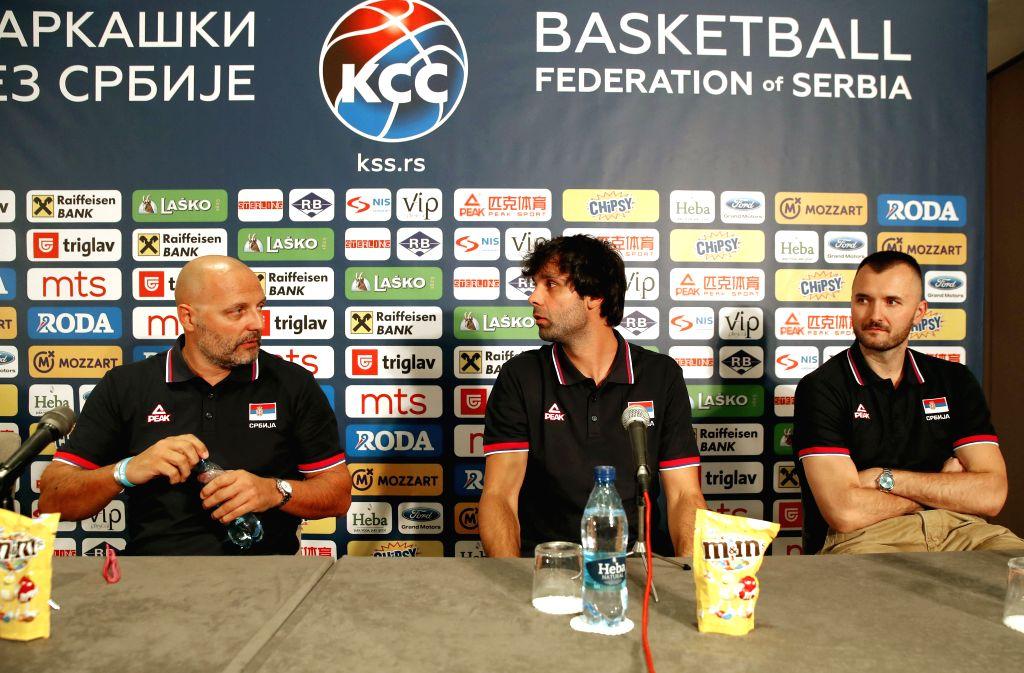 BELGRADE, July 19, 2019 - Serbia's national basketball team head coach Aleksandar Djordjevic (L) speaks to team captain Milos Teodosic (C) and deputy team captain Milan Macvan during a press ... - Milos Teodosic