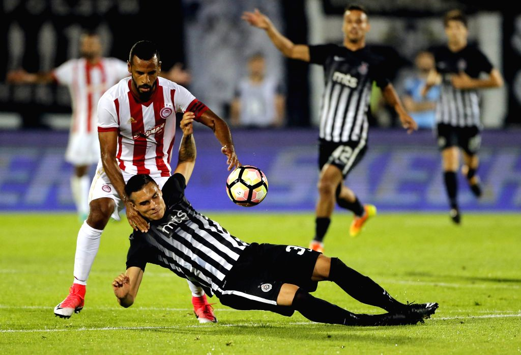 BELGRADE, July 26, 2017 - Partizan's Uros Djurdjevic (bottom) vies with Olympiacos's Alaixys Romao during the UEFA Champions League qualifying football match between Partizan and Olympiacos in ...