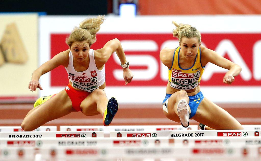 BELGRADE, March 4, 2017 - Karolina Koleczek of Poland (L) and Maja Rogemyr of Sweden compete in women's 60-meter hurdles during the 2017 European Athletics Indoor Championships at the Kombank Arena ...