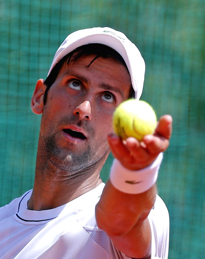 BELGRADE, May 2, 2018 - Serbia's tennis player Novak Djokovic serves a ball during an open training session in Belgrade, Serbia on May 2, 2018.