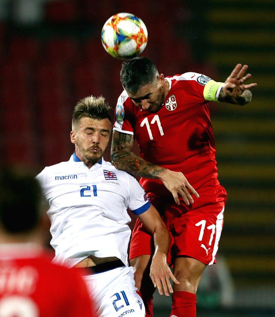 BELGRADE, Nov. 15, 2019 - Serbia's Aleksandar Kolarov (R) vies with Luxembourg's Maurice Deville during the group B match at the UEFA Euro 2020 qualifier in Belgrade, Serbia on Nov. 14, 2019. Serbia ...