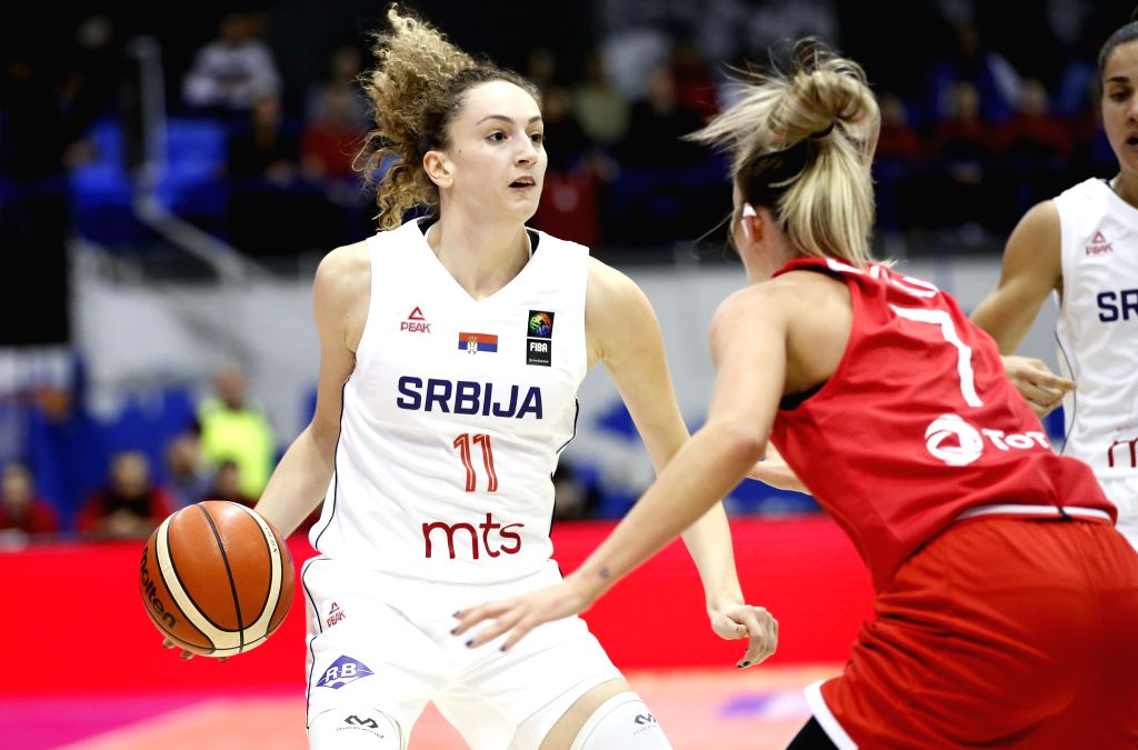 BELGRADE, Nov. 15, 2019 - Serbia's Aleksandra Crvendakic (L) breaks through against Turkey's Cansu Koksal during the Group E match between Serbia and Turkey at the FIBA Women's EuroBasket 2021 ...