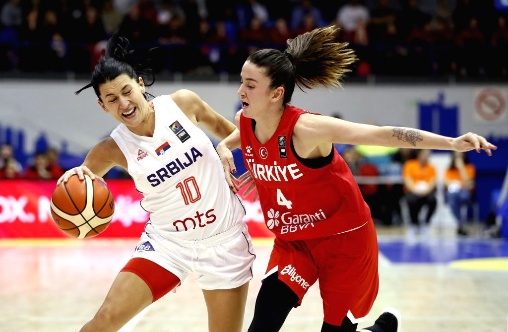 BELGRADE, Nov. 15, 2019 - Serbia's Dajana Butulija (L) vies with Turkey's Olcay Cakir during the Group E match between Serbia and Turkey at the FIBA Women's EuroBasket 2021 Qualifiers in Belgrade, ...