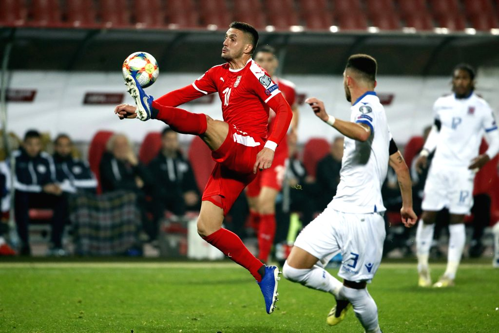 BELGRADE, Nov. 15, 2019 - Serbia's Dusan Tadic (L) vies with Luxembourg's Tim Hall during the group B match at the UEFA Euro 2020 qualifier in Belgrade, Serbia on Nov. 14, 2019. Serbia won 3-2.