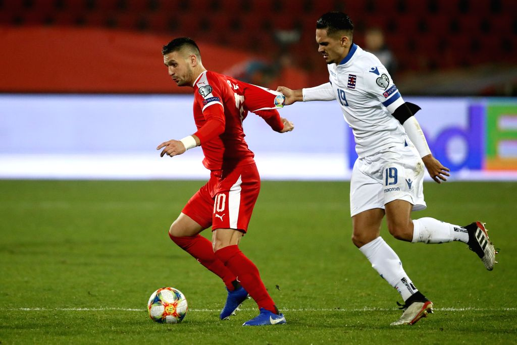 BELGRADE, Nov. 15, 2019 - Serbia's Dusan Tadic (L) vies with Luxembourg's Aldin Skenderovic during the group B match at the UEFA Euro 2020 qualifier in Belgrade, Serbia on Nov. 14, 2019. Serbia won ...