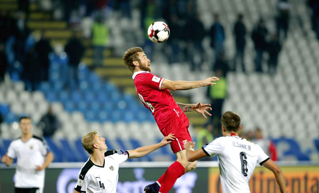 BELGRADE, Oct. 10, 2016 - Serbia's Aleksandar Katai (C) vies with Austria's Martin Hinteregger (L) and Stefan Ilsanker during the 2018 FIFA World Cup European Zone Qualifiers between Serbia and ...
