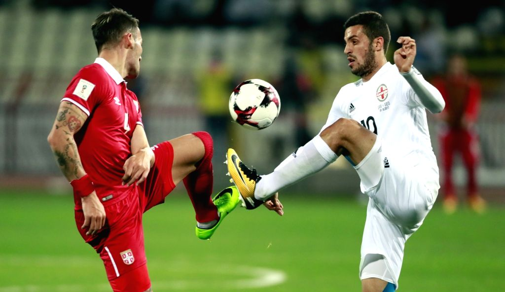 BELGRADE, Oct. 10, 2017 - Serbia's Nemanja Gudelj (L) vies with Georgia's Giorgi Aburjania during the FIFA World Cup Qualifying Group D match between Serbia and Georgia in Belgrade, Serbia on Oct. 9, ...