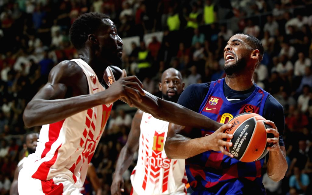 BELGRADE, Oct. 25, 2019 - Barcelona's Brandon Davies (R) vies with Crvena Zvezda's Mouhammad Faye (L) during the regular season Round 4 match at EuroLeague basketball tournament between Crvena Zvezda ...