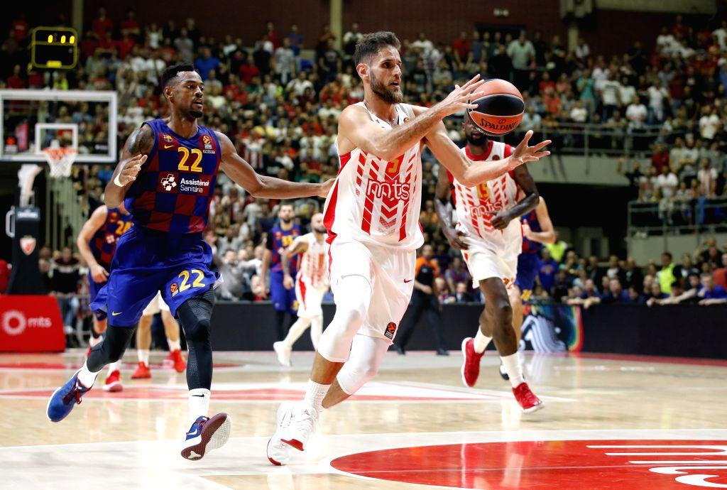 BELGRADE, Oct. 25, 2019 - Crvena Zvezda's Stratos Perperoglou (R) vies with Barcelona's Cory Higgins (L) during the regular season Round 4 match at EuroLeague basketball tournament between Crvena ...