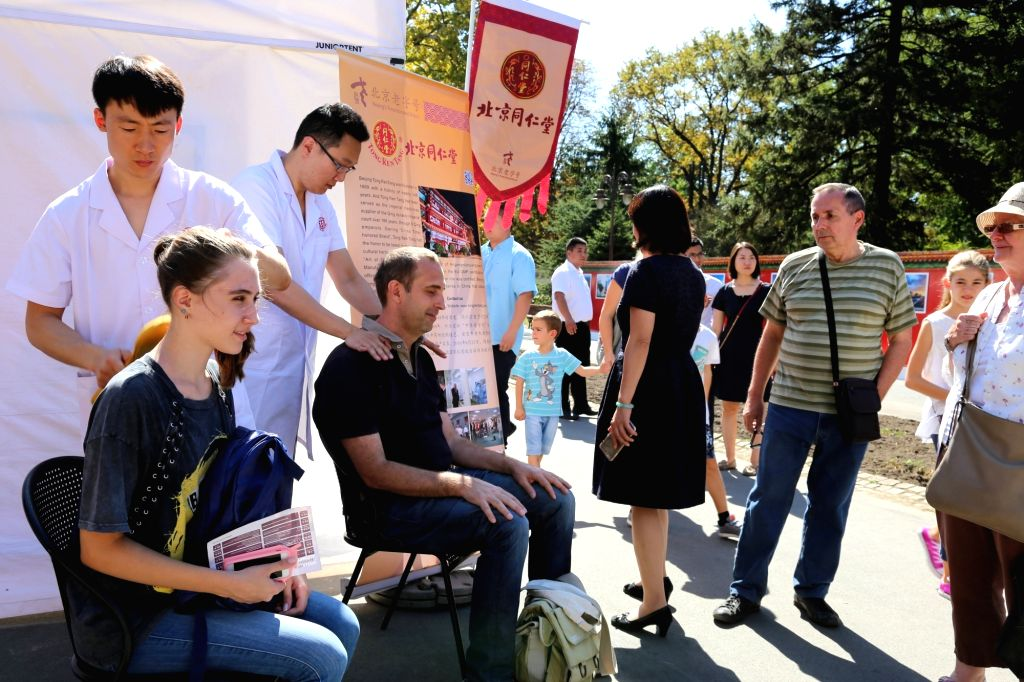 "BELGRADE, Sept. 16 Serbian citizens experience Chinese traditional massage during the event ""Days of Beijing in Belgrade"" at the Kalemegdan medieval fortress in downtown ..."
