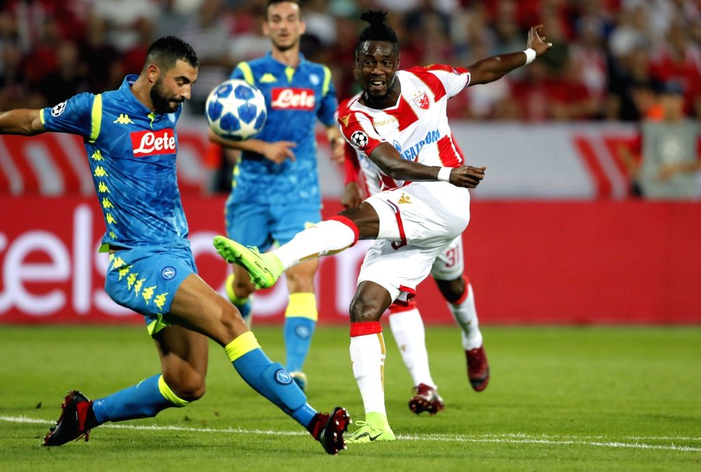 BELGRADE, Sept. 19, 2018 - Crvena Zvezda's Richmond Boakye (R) vies with Napoli's Raul Albiol during a UEFA Champions League group C match between Crvena Zvezda and Napoli in Belgrade, Serbia, on ...