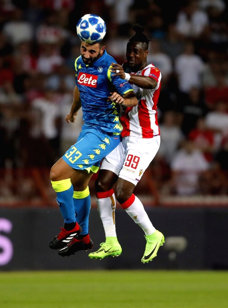 BELGRADE, Sept. 19, 2018 - Crvena Zvezda's Richmond Boakye (R) competes with Napoli's Raul Albiol during a UEFA Champions League group C match between Crvena Zvezda and Napoli in Belgrade, Serbia, on ...