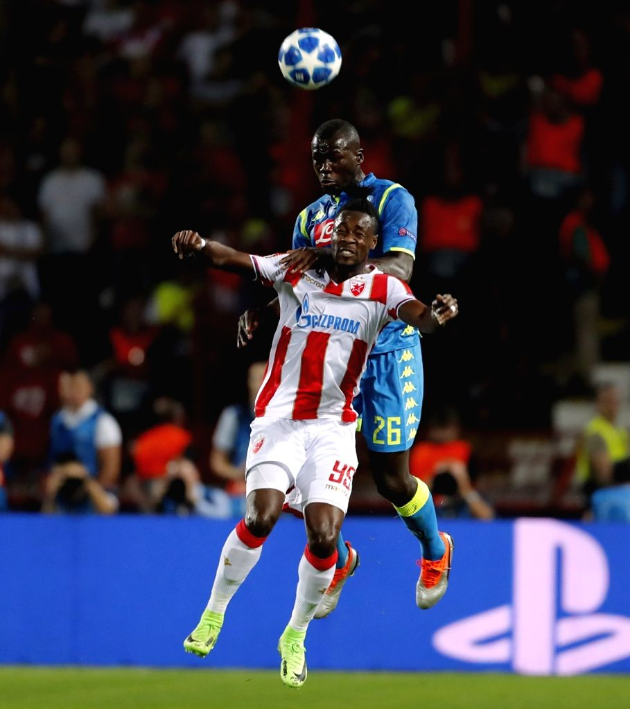 BELGRADE, Sept. 19, 2018 - Crvena Zvezda's Richmond Boakye (front) competes with Napoli's Kalidou Koulibaly during a UEFA Champions League group C match between Crvena Zvezda and Napoli in Belgrade, ...