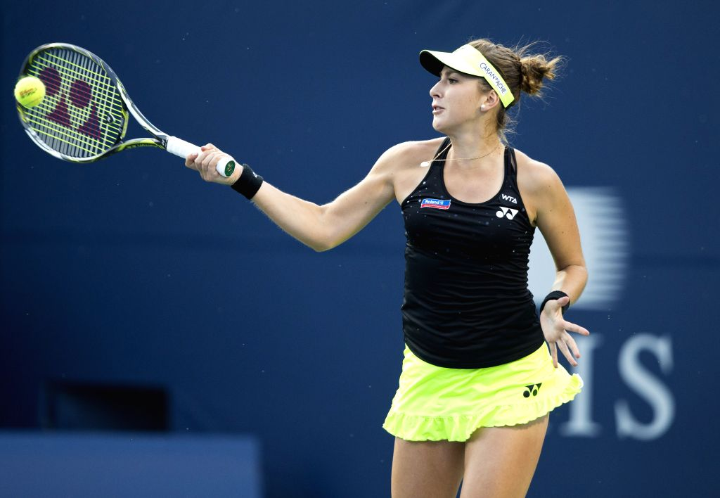 Belinda Bencic of Switerland returns the ball against Serena Williams of the United States during their semifinal match of women's singles at the 2015 Rogers Cup in ...