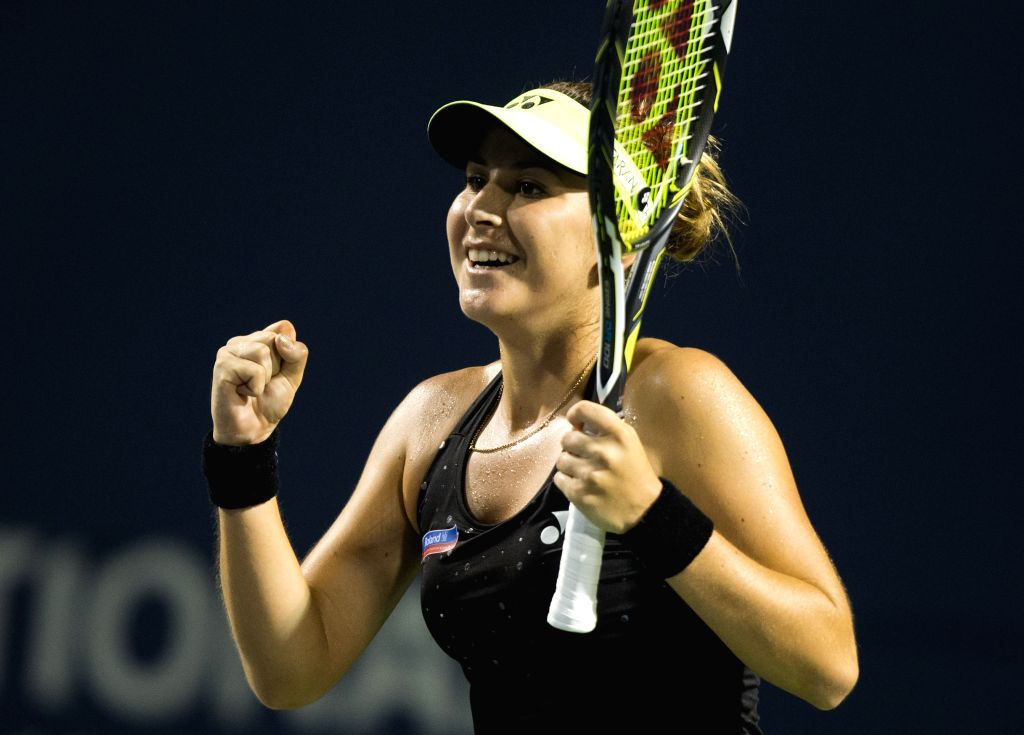 Belinda Bencic of Switzerland celebrates victory after the quarterfinal match of women's singles against Ana Ivanovic of Serbia at the 2015 Rogers Cup in Toronto, ...