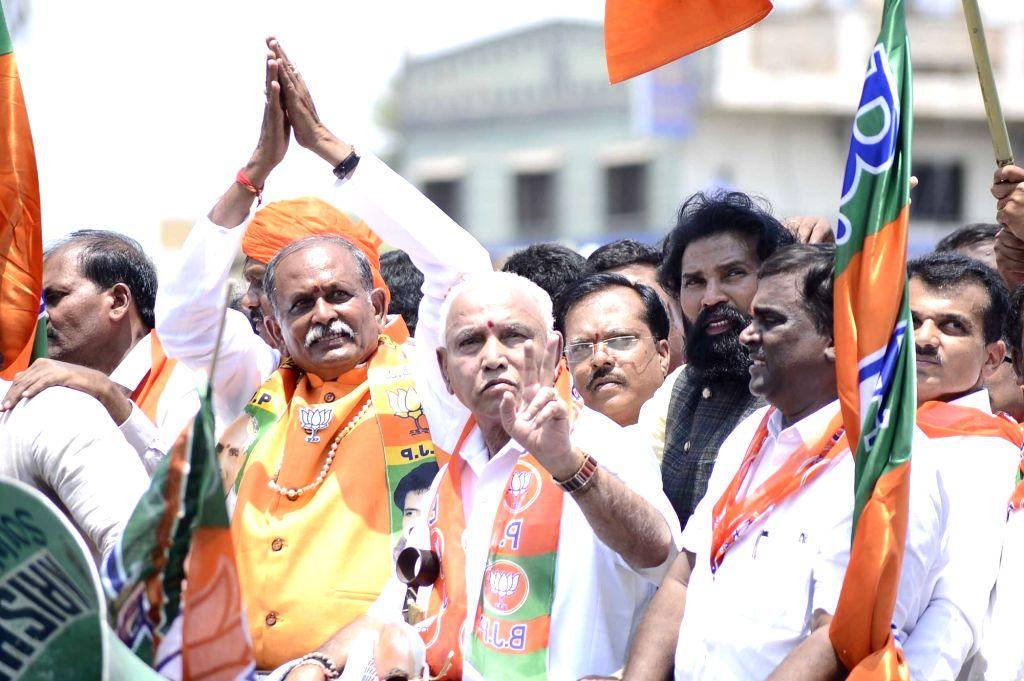 Bellary: BJP's Lok Sabha candidate from Bellary, Devendrappa accompanied by the party's Karnataka President B. S. Yeddyurappa during a roadshow ahead of filing his nomination for 2019 Lok Sabha elections in Karnataka's Bellary on April 2, 2019. (Phot