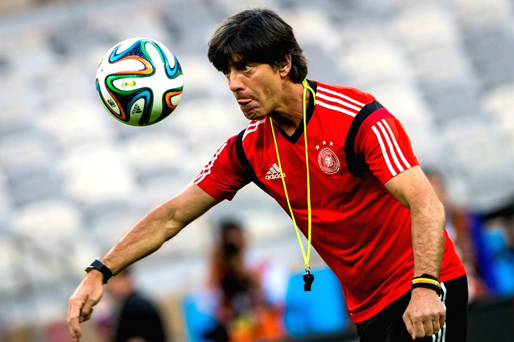 Joachim Loew, head coach of Germany kicks a ball ahead of a training session in Belo Horizonte, Brazil, on July 7, 2014. Germany will play Brazil in their ...