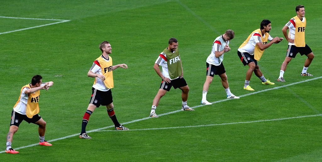 Players of Germany warm up ahead of a training session in Belo Horizonte, Brazil, on July 7, 2014. Germany will play Brazil in their 2014 World Cup semifinal .